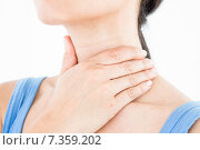 Купить «Brunette with throat pain», фото № 7359202, снято 5 декабря 2014 г. (c) Wavebreak Media / Фотобанк Лори