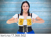 Купить «Composite image of pretty oktoberfest girl holding beer tankards», фото № 7368502, снято 14 июля 2018 г. (c) Wavebreak Media / Фотобанк Лори