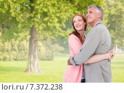 Купить «Composite image of casual couple hugging and smiling», фото № 7372238, снято 20 июля 2019 г. (c) Wavebreak Media / Фотобанк Лори