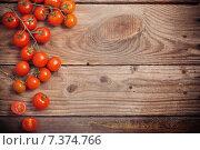 Купить «cherry tomatoes on rustic wooden background», фото № 7374766, снято 22 апреля 2015 г. (c) Майя Крученкова / Фотобанк Лори