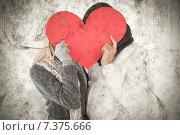 Купить «Composite image of couple in winter fashion posing with heart shape», фото № 7375666, снято 23 января 2020 г. (c) Wavebreak Media / Фотобанк Лори
