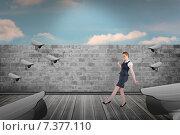 Купить «Composite image of businesswoman doing a balancing act», фото № 7377110, снято 18 февраля 2019 г. (c) Wavebreak Media / Фотобанк Лори
