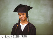 Купить «Little girl wearing graduation robe», фото № 7384790, снято 9 ноября 2014 г. (c) Wavebreak Media / Фотобанк Лори