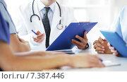 Купить «group of doctors meeting at hospital office», видеоролик № 7387446, снято 22 марта 2015 г. (c) Syda Productions / Фотобанк Лори