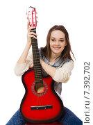 Купить «Young smiling girl with guitar isolated on white», фото № 7392702, снято 20 декабря 2014 г. (c) Elnur / Фотобанк Лори