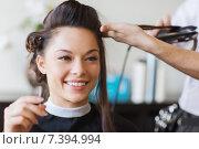 Купить «happy woman with stylist making hairdo at salon», фото № 7394994, снято 15 февраля 2015 г. (c) Syda Productions / Фотобанк Лори