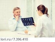 Купить «female doctor with old man looking at x-ray», фото № 7396410, снято 12 октября 2013 г. (c) Syda Productions / Фотобанк Лори