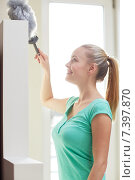 Купить «happy woman with duster cleaning at home», фото № 7397870, снято 25 января 2015 г. (c) Syda Productions / Фотобанк Лори