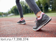 close up of woman feet running on track from back. Стоковое фото, фотограф Syda Productions / Фотобанк Лори