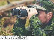 Купить «young soldier or hunter with binocular in forest», фото № 7398694, снято 14 августа 2014 г. (c) Syda Productions / Фотобанк Лори