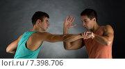 Купить «young men wrestling», фото № 7398706, снято 22 сентября 2014 г. (c) Syda Productions / Фотобанк Лори