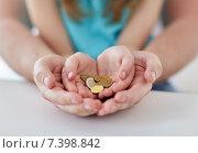 Купить «close up of family hands holding euro money coins», фото № 7398842, снято 10 июля 2019 г. (c) Syda Productions / Фотобанк Лори