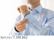 Купить «close up of man fastening buttons on shirt sleeve», фото № 7398862, снято 13 ноября 2014 г. (c) Syda Productions / Фотобанк Лори