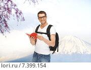 Купить «happy young man with backpack and book travelling», фото № 7399154, снято 8 апреля 2012 г. (c) Syda Productions / Фотобанк Лори