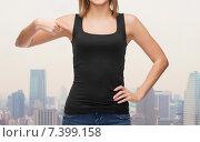 Купить «close up of woman in blank black tank top», фото № 7399158, снято 5 декабря 2013 г. (c) Syda Productions / Фотобанк Лори