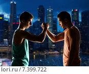 Купить «two young men arm wrestling», фото № 7399722, снято 22 сентября 2014 г. (c) Syda Productions / Фотобанк Лори