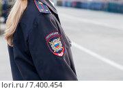 Купить «Погон и нарукавный шеврон лейтенанта полиции России», фото № 7400454, снято 4 мая 2015 г. (c) FotograFF / Фотобанк Лори