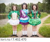 Купить «Три молодые женщины в платье для ирландского танца», фото № 7402470, снято 29 июня 2014 г. (c) Darkbird77 / Фотобанк Лори