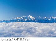Купить «Kings of the Himalaya mountain range, Nuptse, Mount Everest and Lhotse, with blanket of clouds below», фото № 7418178, снято 6 сентября 2006 г. (c) Caro Photoagency / Фотобанк Лори