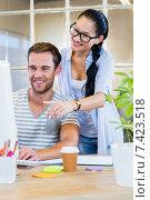 Купить «Smiling partners working together on computer», фото № 7423518, снято 22 марта 2015 г. (c) Wavebreak Media / Фотобанк Лори