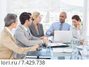 Купить «Business team having a meeting», фото № 7429738, снято 14 марта 2015 г. (c) Wavebreak Media / Фотобанк Лори