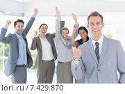 Купить «Business team celebrating a good job», фото № 7429870, снято 14 марта 2015 г. (c) Wavebreak Media / Фотобанк Лори