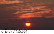 Купить «Восход. Красное солнце светит сквозь облака. Timelapse. Скорость х64.», видеоролик № 7435554, снято 9 августа 2013 г. (c) Mike The / Фотобанк Лори