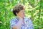 У пожилой женщины болит шея в парке, фото № 7451194, снято 8 мая 2015 г. (c) Володина Ольга / Фотобанк Лори