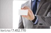 Купить «close up of businessman showing white blank card», видеоролик № 7452770, снято 12 апреля 2015 г. (c) Syda Productions / Фотобанк Лори