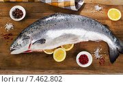 Купить «Atlantic Salmon with lemon on a wooden board», фото № 7462802, снято 4 апреля 2015 г. (c) Tatjana Baibakova / Фотобанк Лори