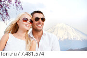 Купить «happy couple over fuji mountain in japan», фото № 7481574, снято 14 июля 2013 г. (c) Syda Productions / Фотобанк Лори