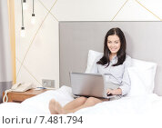 Купить «happy businesswoman with laptop in hotel room», фото № 7481794, снято 23 ноября 2013 г. (c) Syda Productions / Фотобанк Лори