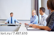 Купить «group of smiling businesspeople meeting in office», фото № 7497610, снято 25 октября 2014 г. (c) Syda Productions / Фотобанк Лори
