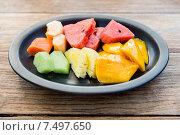Купить «plate of fresh juicy fruits at asian restaurant», фото № 7497650, снято 14 февраля 2015 г. (c) Syda Productions / Фотобанк Лори