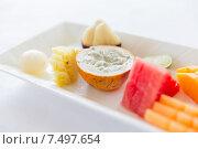 Купить «plate of fresh juicy fruit dessert at restaurant», фото № 7497654, снято 21 февраля 2015 г. (c) Syda Productions / Фотобанк Лори