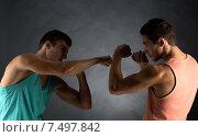 Купить «young men wrestling», фото № 7497842, снято 22 сентября 2014 г. (c) Syda Productions / Фотобанк Лори