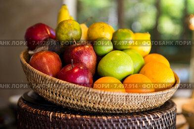 basket of fresh ripe juicy fruits at kitchen