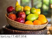 basket of fresh ripe juicy fruits at kitchen. Стоковое фото, фотограф Syda Productions / Фотобанк Лори