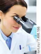 Купить «close up of scientist looking to microscope in lab», фото № 7498166, снято 4 декабря 2014 г. (c) Syda Productions / Фотобанк Лори
