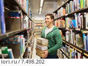 Купить «happy student or man with book in library», фото № 7498202, снято 6 марта 2015 г. (c) Syda Productions / Фотобанк Лори