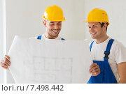 Купить «group of builders with blueprint», фото № 7498442, снято 25 сентября 2014 г. (c) Syda Productions / Фотобанк Лори