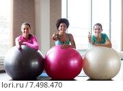 Купить «group of smiling women with exercise balls in gym», фото № 7498470, снято 5 апреля 2015 г. (c) Syda Productions / Фотобанк Лори