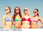 Купить «group of smiling young women on beach», фото № 7498562, снято 26 июля 2014 г. (c) Syda Productions / Фотобанк Лори