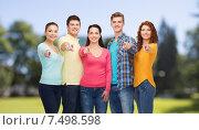 Купить «group of smiling teenagers over green park», фото № 7498598, снято 22 июня 2014 г. (c) Syda Productions / Фотобанк Лори