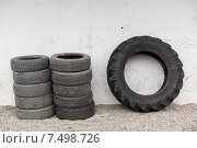 Купить «close up of wheel tires stored near wall», фото № 7498726, снято 28 марта 2015 г. (c) Syda Productions / Фотобанк Лори