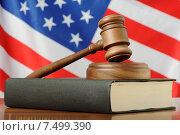 Купить «Американское правосудие - судейский молоток на фоне флага США», фото № 7499390, снято 23 мая 2015 г. (c) Денис Ларкин / Фотобанк Лори