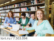 Купить «happy student girl writing to notebook in library», фото № 7503094, снято 6 марта 2015 г. (c) Syda Productions / Фотобанк Лори