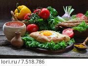 Купить «Хачапури, люля-кебаб, вино, салат, помидоры, перец, кинза, острый соус на деревянном столе», фото № 7518786, снято 30 мая 2015 г. (c) Марина Володько / Фотобанк Лори