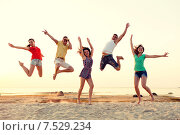 Купить «smiling friends dancing and jumping on beach», фото № 7529234, снято 3 августа 2014 г. (c) Syda Productions / Фотобанк Лори