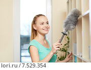 Купить «happy woman with duster cleaning at home», фото № 7529354, снято 25 января 2015 г. (c) Syda Productions / Фотобанк Лори